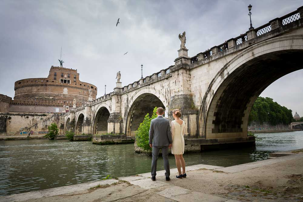 Couple wedding day photo session underneath the Castel Sant Angelo bridge in Rome Italy