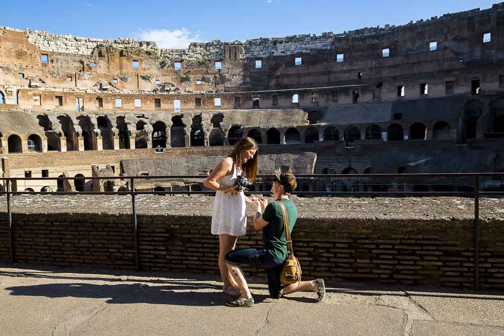 Wedding proposal picture taken inside the Collosseum in Rome Italy.
