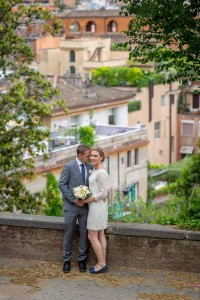 Overview of a bride and groom before the roman rooftops