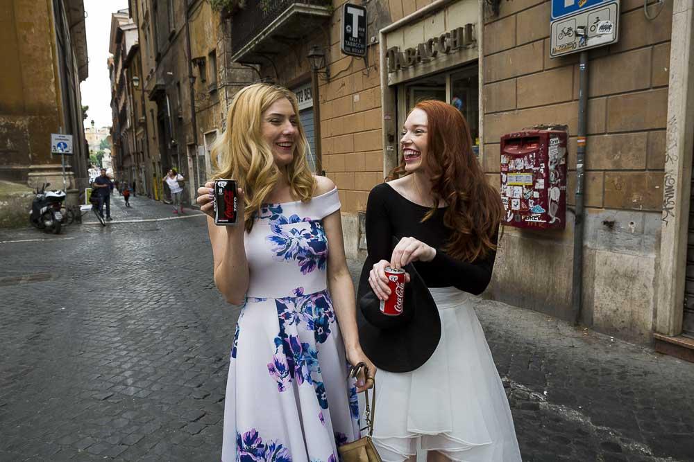 Girls walking in the back alleyways with a soda pop