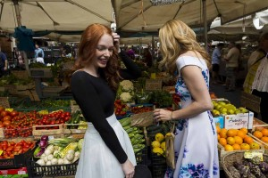 Shopping for fruits and vegetables inside the Campo dei Fiori morning market