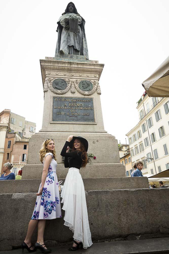Posing underneath the statue of Giordano Bruno