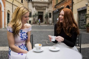 Friend haing a cappuccino coffee at a bar in Rome during a photoshoot session with a professional lifestyle photographer