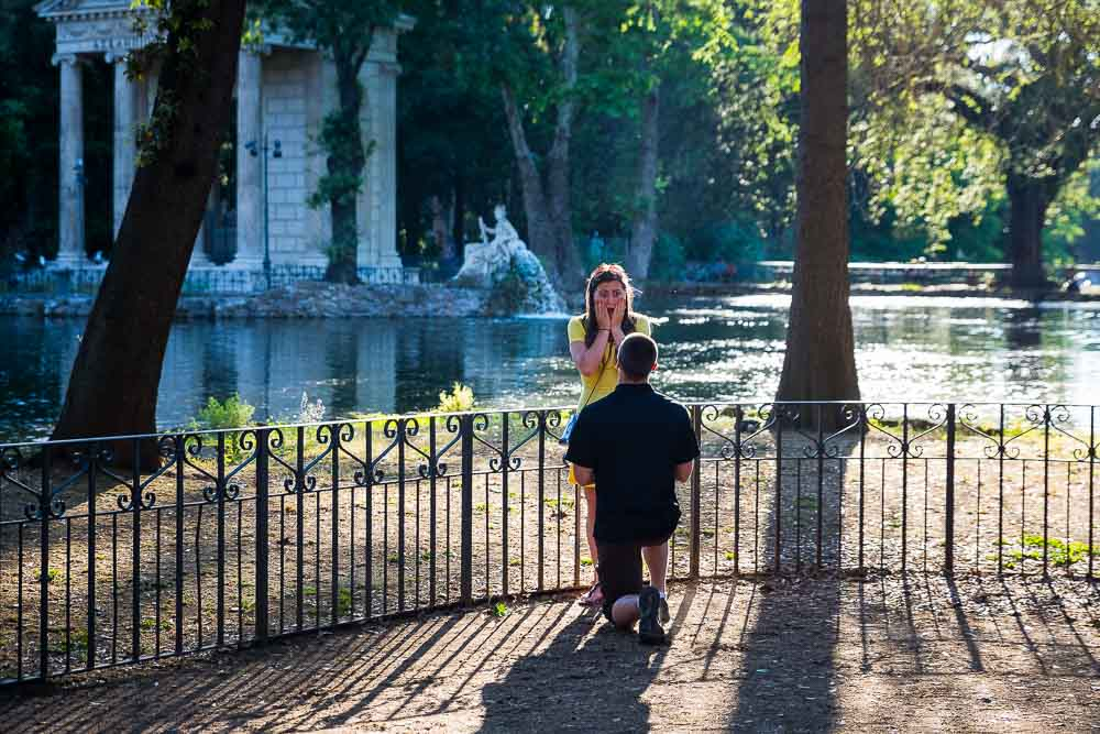 Rome marriage proposal in Italy by the side of the lake Villa Borghese