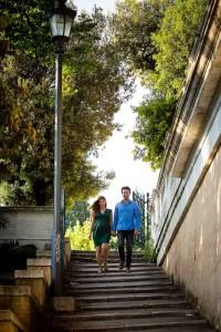 Couple walking down the steps in Parco del Pincio