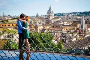 Couple in love kissing before the panoramic view of the city of Rome from above