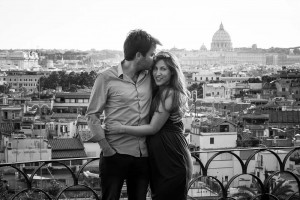 Black and white image of a couple over the roman rooftops