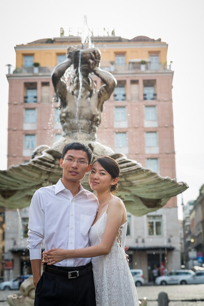 Post wedding photo shoot in Piazza Barberini by the water fountain