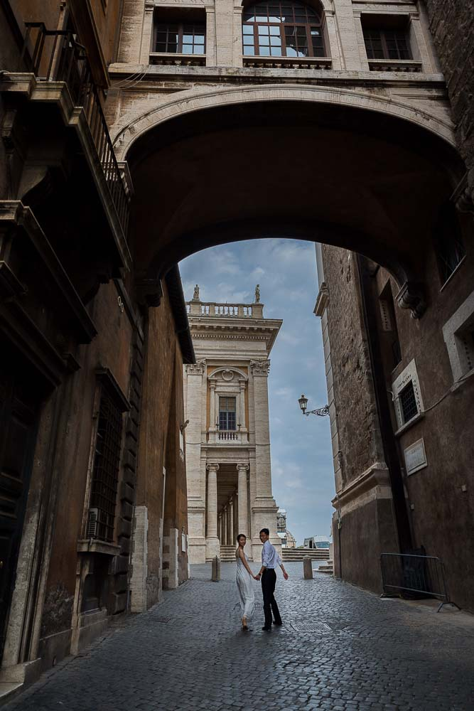 Romantic walk underneath a roman bridge