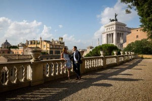 Engaged couple standing by the Vittoriano monument