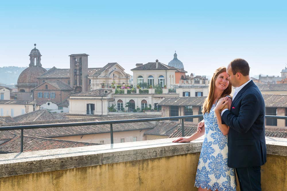 Romantic photoshoot taking place overlooking the roman skyline during a photography shoot