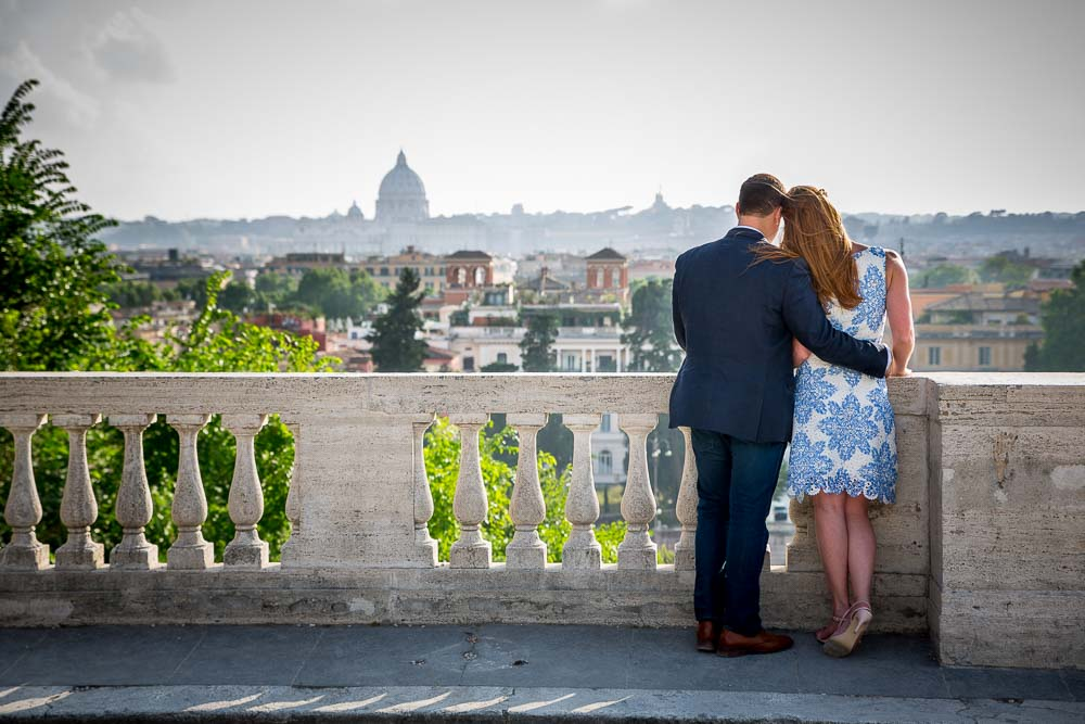 Romantic image of a couple overlooking the city of Rome from afar