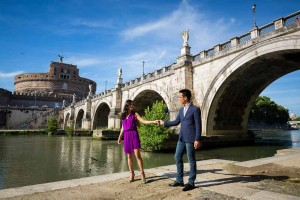Engagement photo session under Castel Sant Angelo by the Tiber river bank