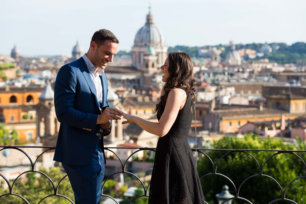 Just engaged couple. Putting the engagement ring on. Romantic proposal in Rome