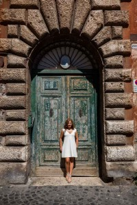 Colorful portrait picture in front of an old green door
