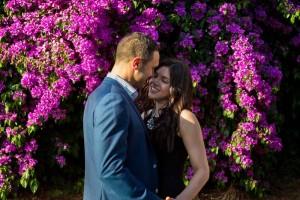Couple photographed by bougainvillea flowers plants