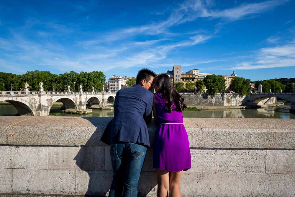 Overlooking together the Tiber river