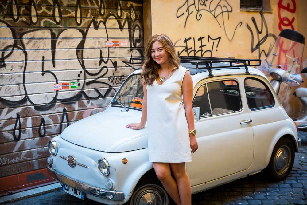 Leaning into a white fiat 500 car