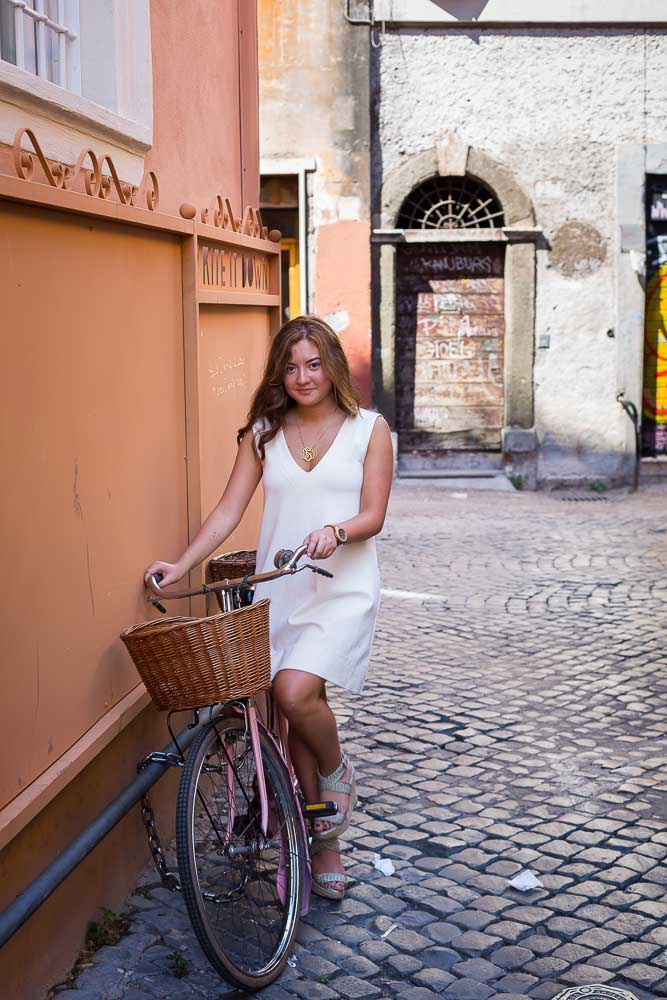 Sitting down on a bicycle in a typical roman environment