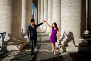 Dance walking under the St. Peter's colonnade in the Vatican city