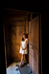 Portrait picture natural light standing in front of a church door