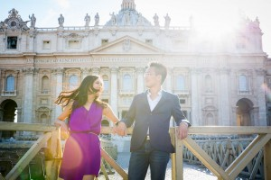 Image of an engaged couple under the Vatican's cathedral