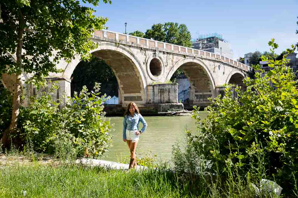 Photo session under the bridge. Standing next to the Tiber river in Rome. Ponte Sisto. Portrait photography.