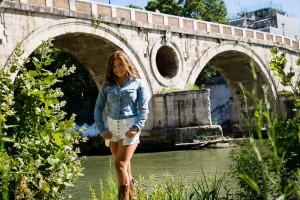 Ponte Sisto photo shoot. Posing under the bridge. Standing next to the Tiber river bank.