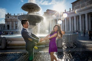 Dancing and splashing around under water splashes from S. Peter square