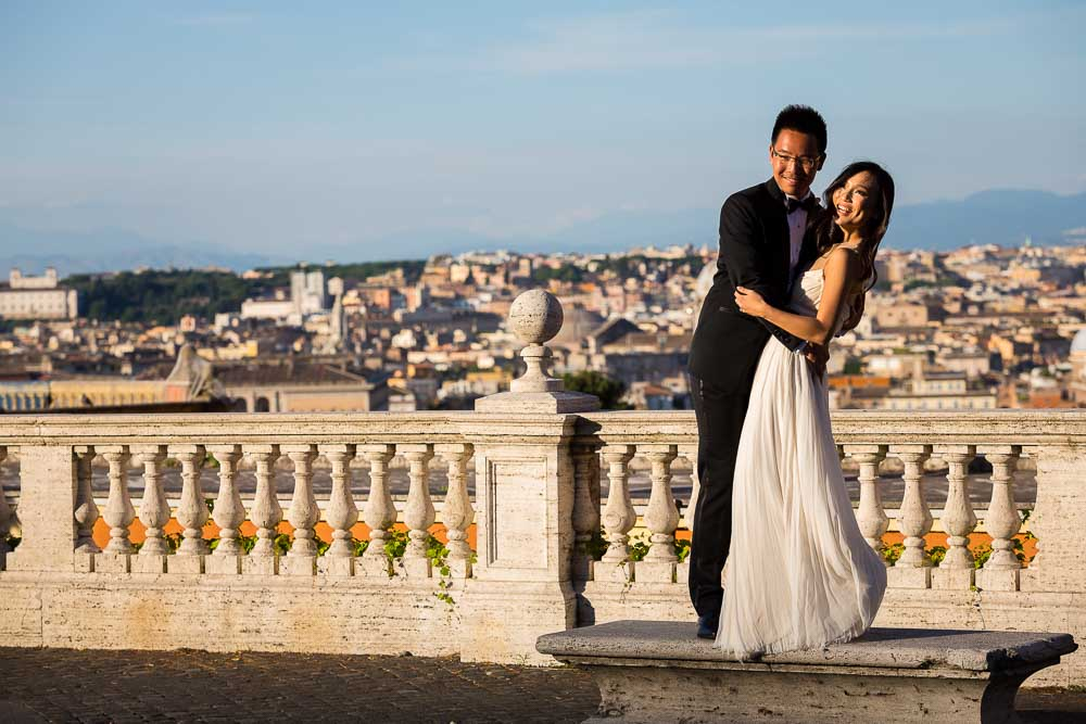 Sunset pictures of bride and groom overlooking the roman skyline