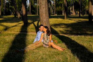 Laying down on the grass by a tree in Park Villa Borghese in Rome Italy.