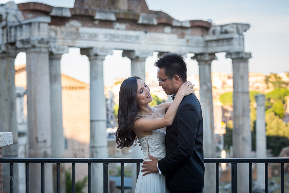 Posing at the Roman Forum during a pre-wedding photo shoot in Rome