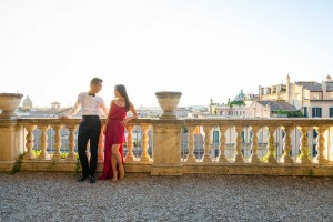 Relaxing together overlooking the roman rooftops in Rome