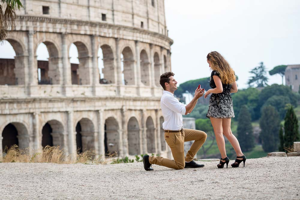 Proposing marriage in Rome. Knee down over the Colosseum's outside facade.
