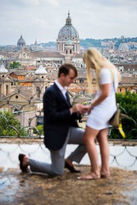 Man asking fiancee for marriage in Rome. Soft focus effect.