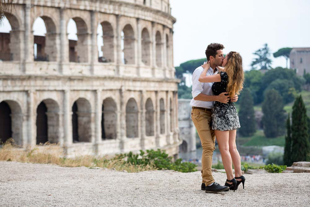 Couple kissing at the Roman Coliseum
