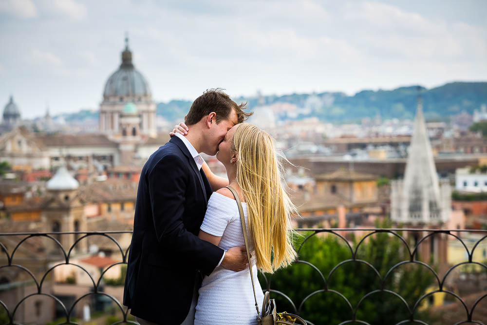 Kissing overlooking the roman rooftops