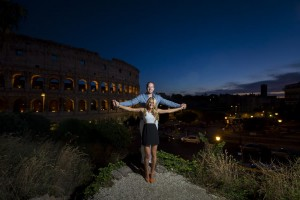 Holding hands overlooking the roman Coliseum