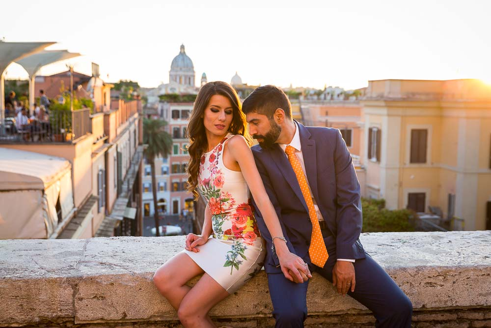 Kissing during an engagement style session in Rome at sun set