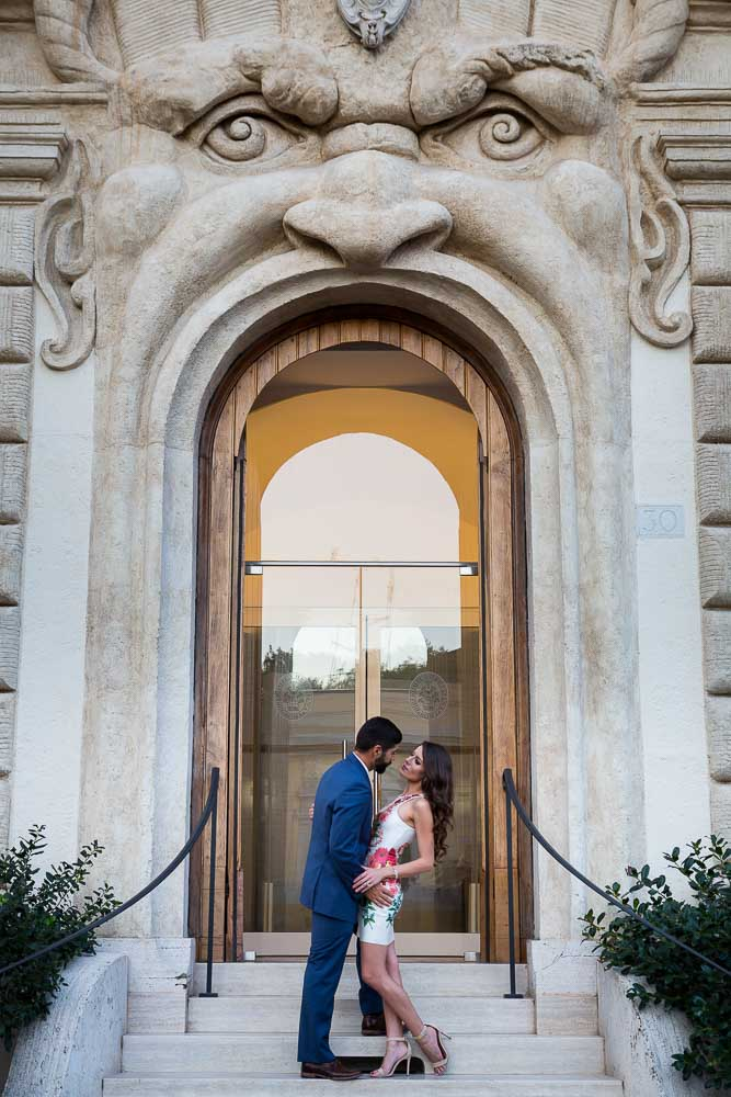 Romantic and love picture of a couple standing in front of a interesting mouth like door entrance