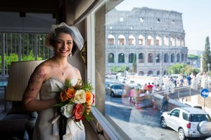 Bride looking out of the window and seeing the Colosseum