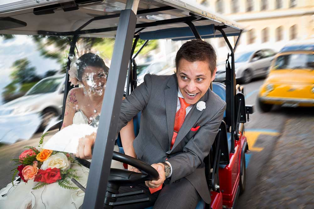 Groom driving a golf cart in between traffic