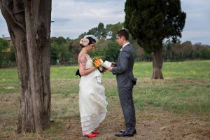 Exchanging of vows in a field during a private wedding