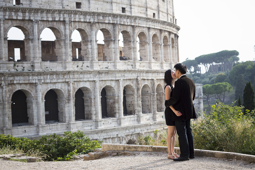 She said yes. Couple kissing in Rome
