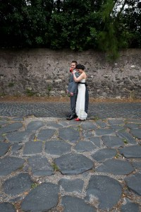 Newlyweds standing on the ancient Appian roman road
