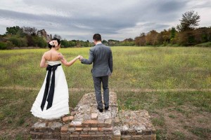 Holding on to each other's hand in a field after a wedding