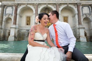 Happy together at a famous water fountain in Rome