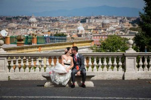 Bride and groom during their photography session in Rome Italy with the roman skyline behind them