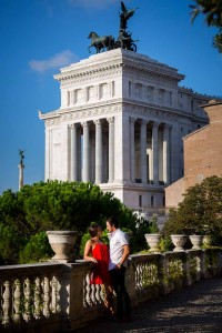 Couple posing in front of the Vittoriano monument in the distance