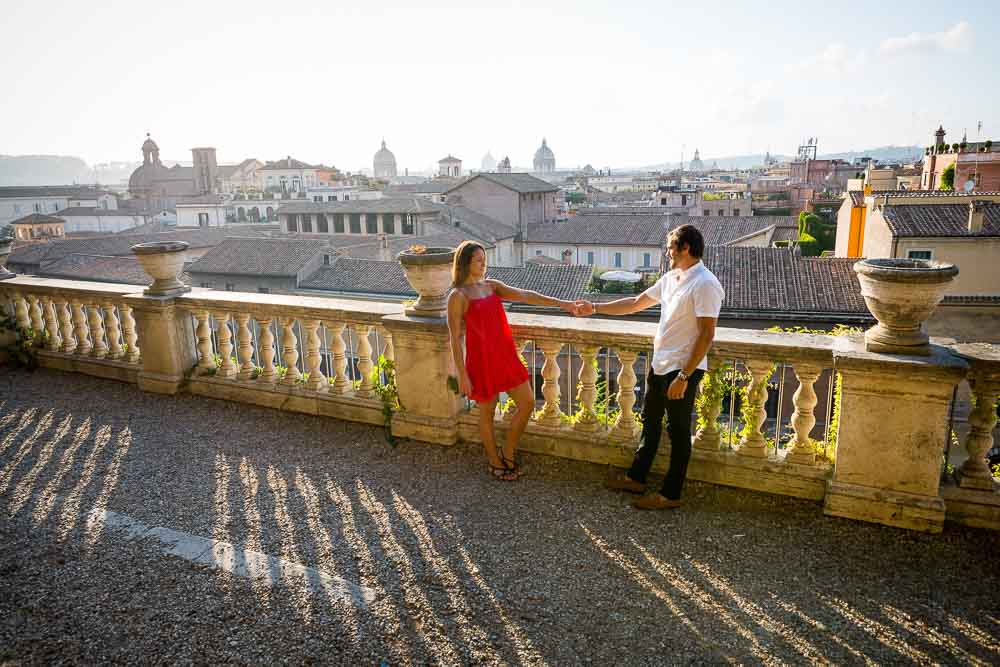 Holding hands photo shoot overlooking the roman rooftops at sunset